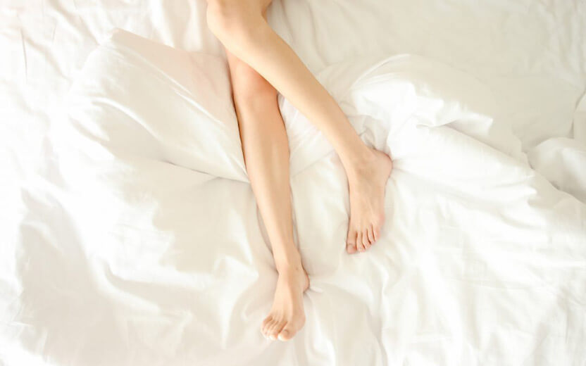 woman legs on white cover