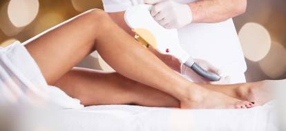 woman's legs during hair removal treatment