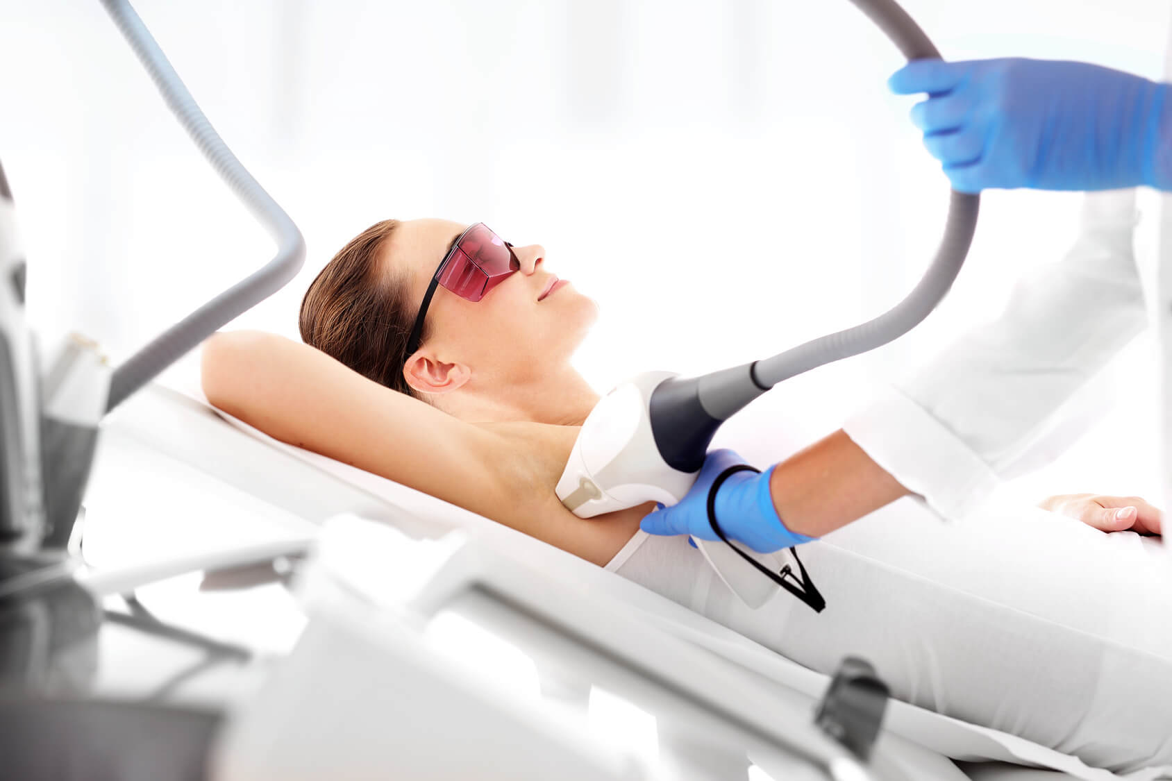 woman laying on bed during laser hair removal treatment